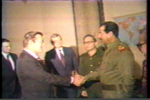 Donald Rumsfeld shakes hands with Saddam Hussein - 19831220